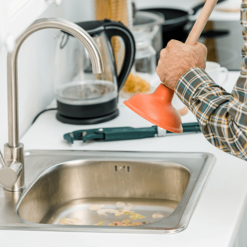 Unclog Your Double Kitchen Sink With A Plunger